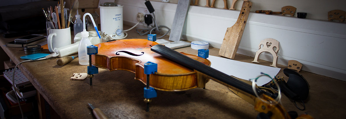 Violin being fixed by Philip Brown